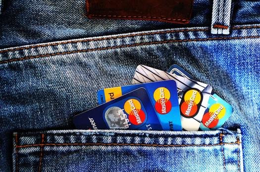 Credit cards sticking out of a pocket